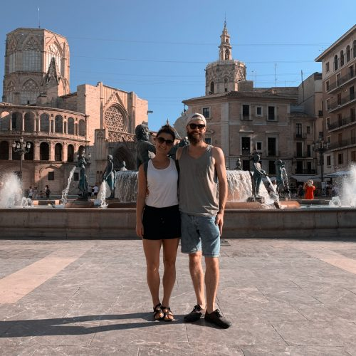 two people in front of a fountain