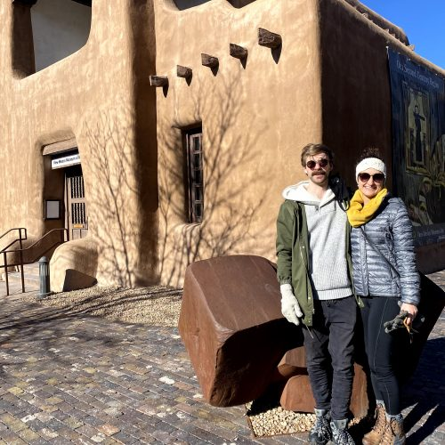 two people in front of a building in santa fe