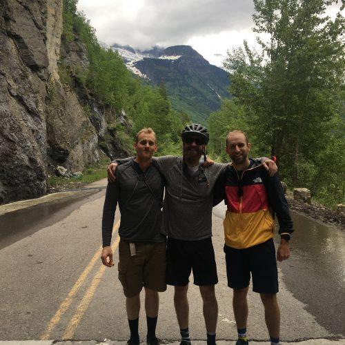 three friends posing on the bike trail