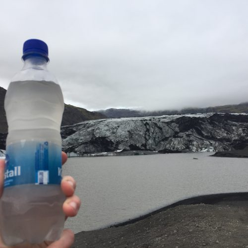 water bottle near glacier in background